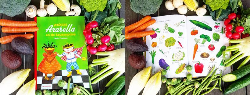 Keukenprins op de witte kool of groenteonderzoek met vierjarige.